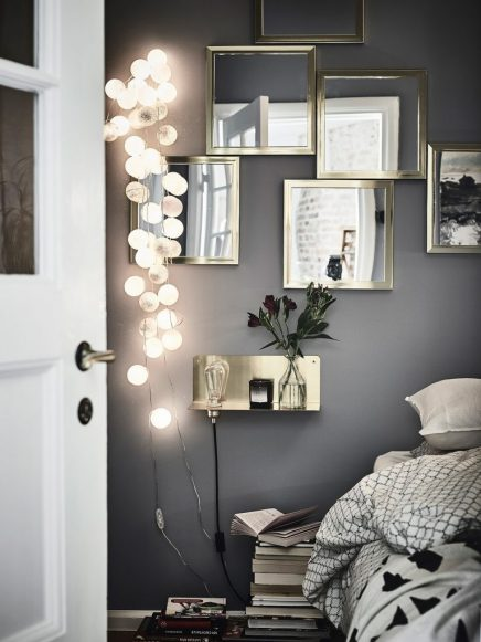 gemutliches-schlafzimmer-mit-grauen-wanden-und-goldenen-details-2