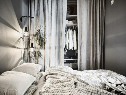 gemutliches-schlafzimmer-mit-grauen-wanden-und-goldenen-details-3