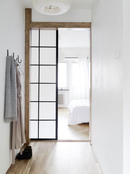 Schlafzimmer mit einer Mischung aus skandinavischen und japanischen ...